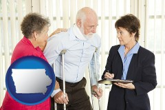 iowa map icon and injured person consulting with a personal injury attorney