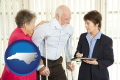 north-carolina map icon and injured person consulting with a personal injury attorney